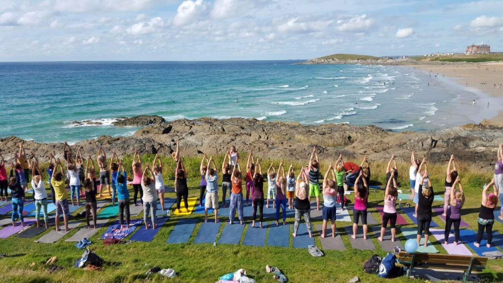 outside yoga newquay cornwall beach fistral vinyasa flow