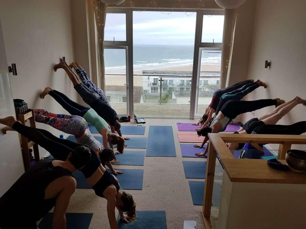 oceanflow yoga inversions workshop newquay cornwall