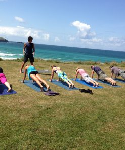 Oceanflow Yoga hot yoga surf retreat Newquay Cornwall UK
