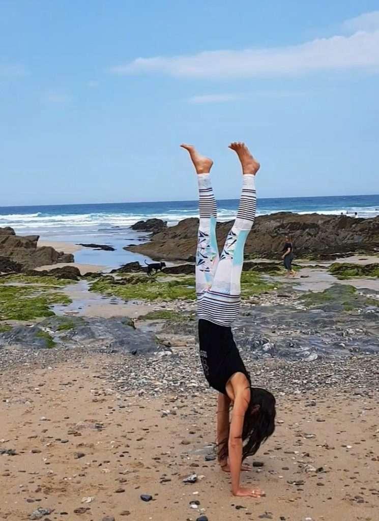 Inversions workshop beach yoga newquay cornwall